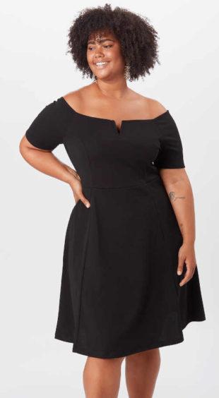 Dámské černé šaty v délce ke kolenům nejen do společnosti