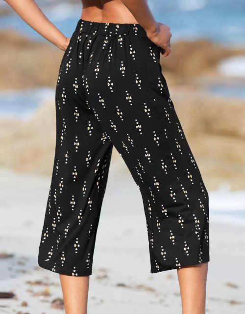 Moderní široké kalhoty v 3-4 délce se zlatým potiskem